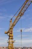 Yellow construction crane over city Stock Photo