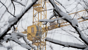Yellow construction crane in snow winter, close up Royalty Free Stock Photos