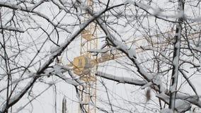 Yellow construction crane in snow winter Stock Photos
