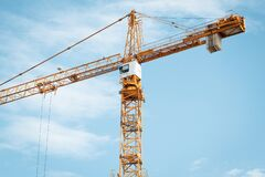 Free Yellow Construction Crane With Cabin Against Blue Sky. Lifting Of Cargo. Construction Machinery Concept, Modern Technology Stock Images - 177213964