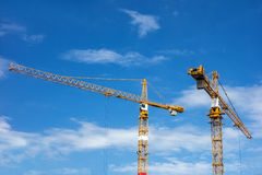 Yellow construction cranes Stock Images