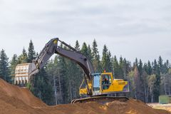 Yellow Construction Excavator at Work Royalty Free Stock Photography