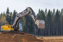 Yellow Construction Excavator at Work Stock Photography