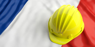 Yellow helmet over France flag. 3d illustration. Yellow construction hat over France flag. 3d illustration Royalty Free Stock Image