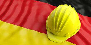Yellow helmet over Germany flag. 3d illustration. Yellow construction hat over Germany flag. 3d illustration Royalty Free Stock Photography
