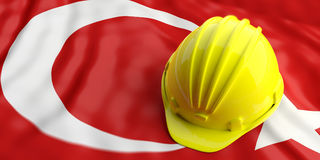 Yellow helmet over Turkey flag. 3d illustration Stock Images