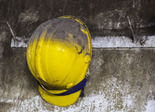 Yellow construction helmet hanging on hat rack. Royalty Free Stock Images