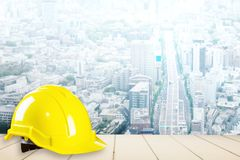 Construction safety helmet with city background Royalty Free Stock Image