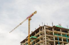 Yellow construction tower crane Stock Images