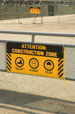 Yellow construction zone sign. On metal barricade Stock Photography