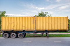 Yellow container box trailer parked. On road Stock Photos