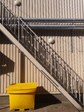Yellow container. Under the stairs. Various shapes and objects stock photos