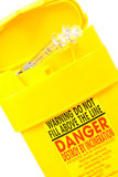 Yellow container for used syringes Royalty Free Stock Images