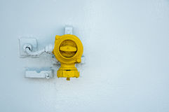 Yellow control  industrial switch on a white metallic surface Stock Photo