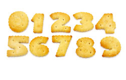 Yellow cookies in the form of figures. On a white background Stock Images