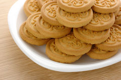 Yellow cookies on plate Royalty Free Stock Photography