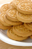 Yellow cookies on plate Royalty Free Stock Images