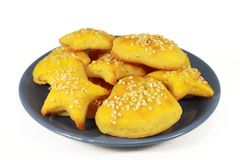 Yellow cookies on a plate Stock Image