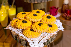 Yellow cookies on the plate derevlany stock image