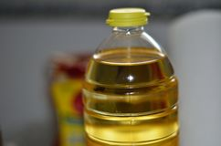 Yellow cooking oil in a plastic transparent bottle. royalty free stock images