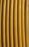 Yellow copper cable in a vertical coil Stock Photos