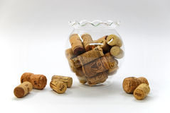 Yellow corks in a glass bowl. On a white Stock Image