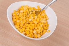 Yellow corn in a bowl on the table Royalty Free Stock Image