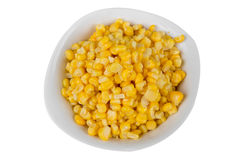 Yellow corn in a bowl Stock Images