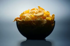 Yellow corn flakes in a bowl Royalty Free Stock Photography