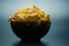 Yellow corn flakes in a bowl Royalty Free Stock Photos
