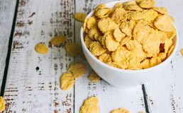 Corn flakes in a bowl on the table royalty free stock image