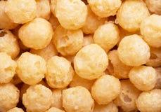 Yellow corn flour balls close-up texture. Stock Photo