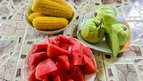Yellow corn and fresh fruit with green guava, red watermelon Stock Photo