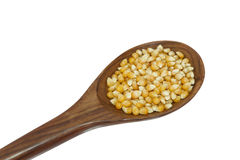 Yellow corn grain and spoon isolated white background Stock Photo