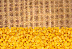 Yellow corn gran over linen texture Royalty Free Stock Image