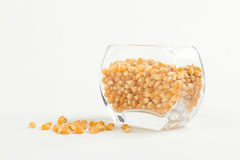 Yellow corn seed for popcorn in a glass bowl Royalty Free Stock Images