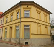 Yellow corner house listed as monument in Guetzkow, Mecklenburg-Vorpommern, Germany Stock Image
