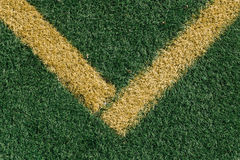 Yellow corner on sports field with artificial grass Royalty Free Stock Image