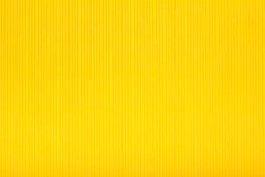 Yellow corrugated cardboard carton, texture background, colorful Stock Photos