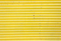 Yellow corrugated metal sheet slide door Stock Photos