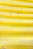 Yellow corrugated metal sheet slide door Stock Photo
