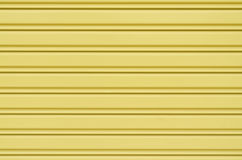 Yellow corrugated metal sheet slide door Royalty Free Stock Photo