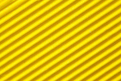 Yellow corrugated paper background Royalty Free Stock Image