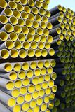 Yellow corrugated pipes for laying electric cables Stock Image
