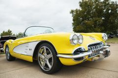 Yellow 1958 Corvette Chevrolet Classic Car. Westlake, Texas - October 21, 2017: A front side view of a yellow 1958 Corvette Chevrolet classic car Royalty Free Stock Photography