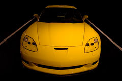 Yellow Corvette sports car. Yellow sports car against black background Royalty Free Stock Image