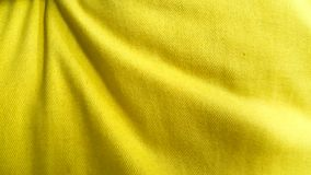 Yellow cotton fabric background. Wrinkle yellow cotton fabric background for plain design with text or other objects royalty free stock photo