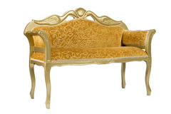 Yellow couch with golden ducks Royalty Free Stock Photo