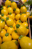 Yellow courgettes at market Stock Photos