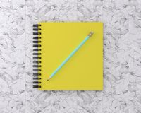 Yellow cover notebook with blue pencil on marble background. Min. Imal work space. Top view , flat lay, The concept of work to plan to achieve the goal Royalty Free Stock Photos
